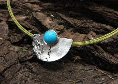 Türkisanhänger aus angeschmortem Silber